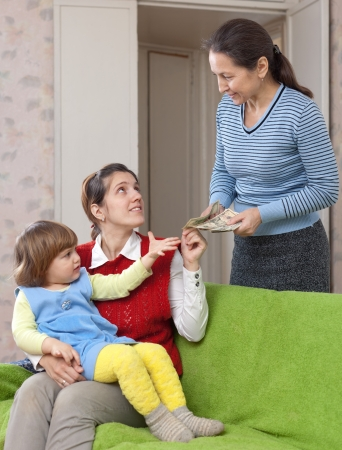 Woman hires nanny for her child at home Stock Photo - 16791474