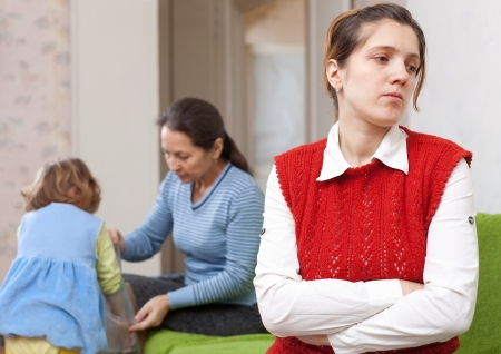 young mother and  grandmother with baby after quarrel at home Stock Photo - 16791489