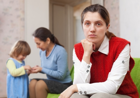 fracas: Sad mother against grandmother and granddaughter Stock Photo