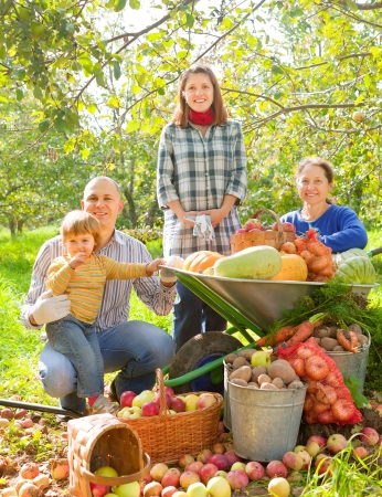 Happy  family with vegetables harvest in garden Stock Photo - 16848579