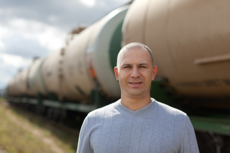 worker near oil cistern car at railway Stock Photo - 16848572