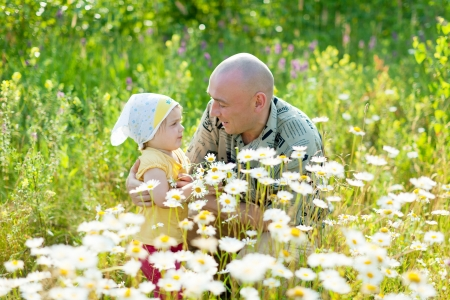 Happy father with daughter in summer daisy plant Stock Photo - 16863196