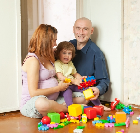 Happy parents and child plays with meccano set in home Stock Photo - 16863243