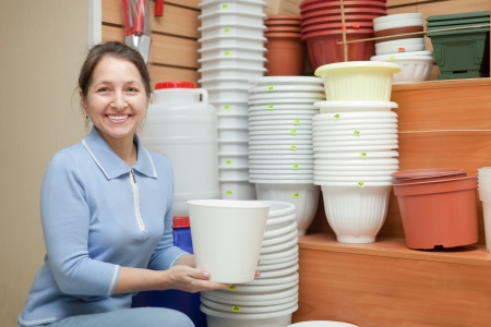Woman chooses a flower pot in the store for gardeners Stock Photo - 16970088