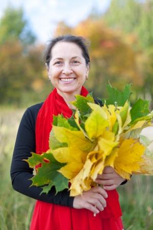 happy mature woman  in autumn park Stock Photo - 16884478