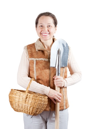 Happy mature  woman   with spade and basket over white Stock Photo - 16884461