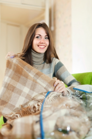 Happy woman with new plaid at home Stock Photo - 16902098
