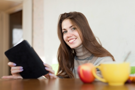 Happy girl with e-book at home Stock Photo - 16902133
