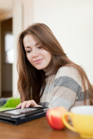 Young woman reads e-reader at home Stock Photo - 16902109