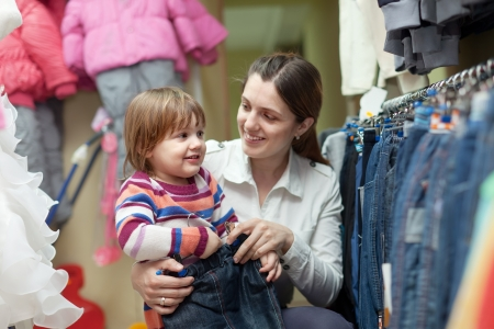 Happy woman and child chooses jeans at shop Stock Photo - 16925018
