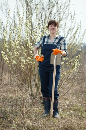 welly: full length shot of woman with spade in spring