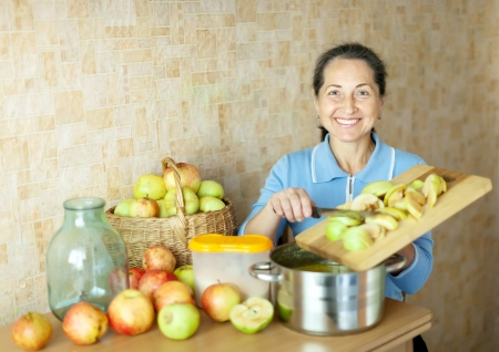Woman cooks apple jam in the kitchen Stock Photo - 16949227