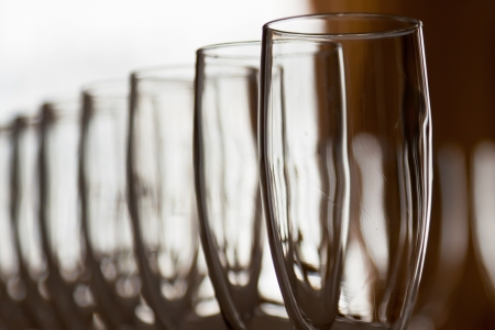 bar ware: Many wineglasses in rows in bar