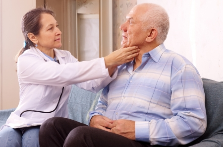 Serious mature doctor examining senior male patient Stock Photo - 16964887