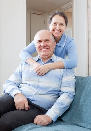Happy mature woman with husband in home Stock Photo - 16964894