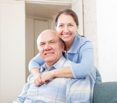 cheerful mature couple in home inter Stock Photo - 16964906