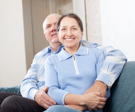 Happy mature couple in home interior photo