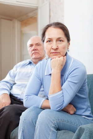 Mature women having problems with her senior husband at home photo