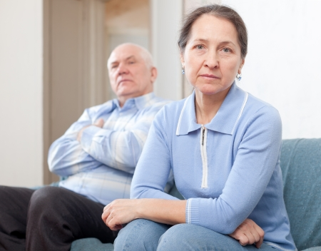 compromise: Mature married couple having quarrel at home Stock Photo