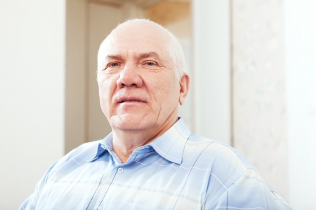 casualy: portrait of quiet grizzled senior man