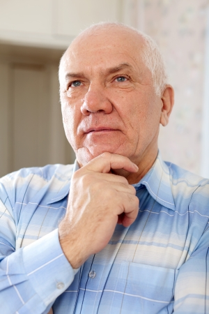 portrait of handsome mature man in interior photo