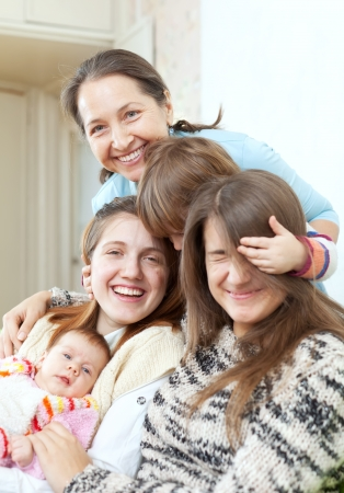 Happy grandmother with her daughters and granddaughters in home Stock Photo - 16974802