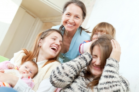 Happy mature woman with her daughters and granddaughters in home Stock Photo - 16974836