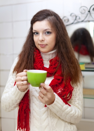 Sich woman with cup of medicine gargling at bathroom Stock Photo - 16982510