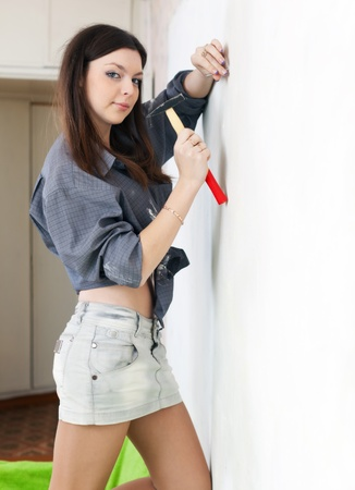 Young woman makes repairs in the apartment Stock Photo - 16982483