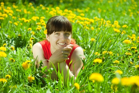 Happy   woman  relaxing outdoor in grass photo