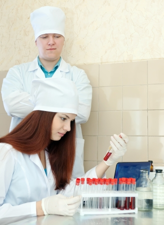 Male doctor supervises the young nurse in medical lab Stock Photo - 17051927