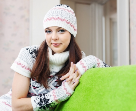 pull over:  girl in knitted hat relaxing at home in winter