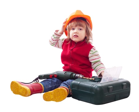 child  chooses tools in toolbox. Isolated over white background Stock Photo - 17155294