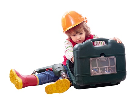 Child in hardhat with working tools. Isolated over white photo