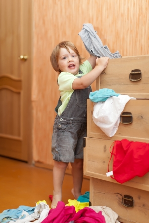 Baby girl  chooses dress in parents closet   photo
