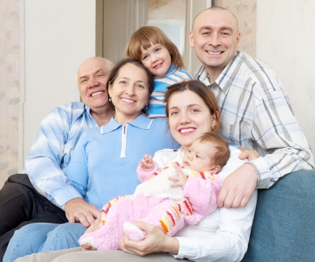 smiling happy three generations family sits on sofa at home Stock Photo - 17181292