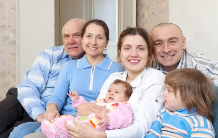 Happy elderly couple with their offspring at home Stock Photo - 17181294