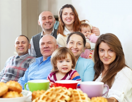 large happy family having tea and baked at home  Stock Photo - 17181296