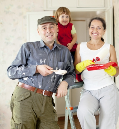 Happy family of three makes makes repairs in the apartment together Stock Photo - 17181284