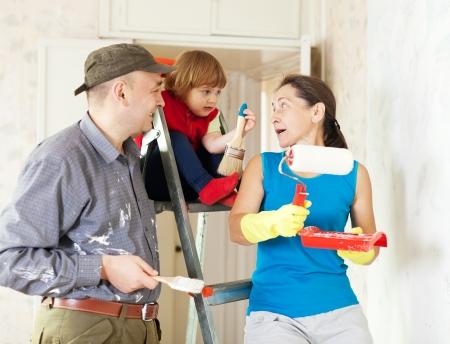 Happy family of three makes repairs at home photo