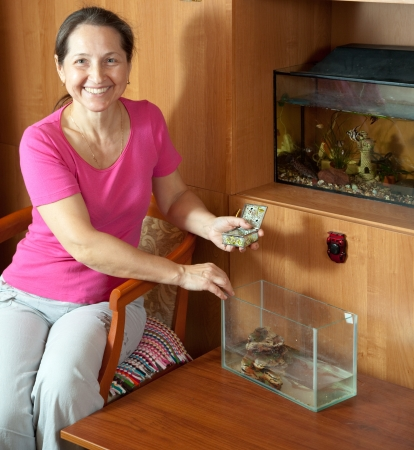 Woman with aquariums in home photo