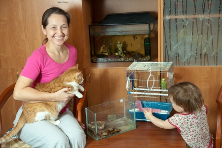 woman and child with  pets in home photo