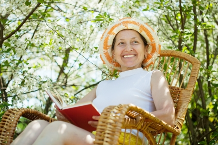 portrait of mature woman in spring blossoming garden Stock Photo - 17230743