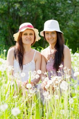 Portrait of two happy women in dandelion plant Stock Photo - 17278562