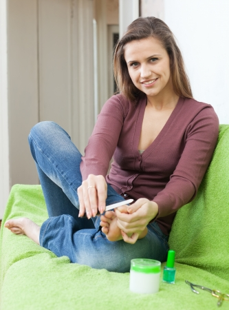 Beautiful girl cares for toenails at home Stock Photo - 17278468