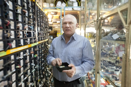 mature man chooses fasteners in  auto parts store Stock Photo - 17335502