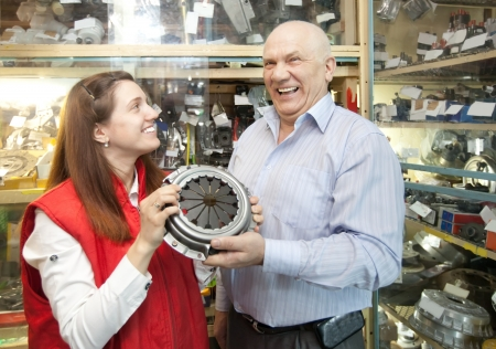 mature man and woman with  clutch  in  auto parts store Stock Photo - 17335493