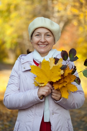 Happy mature woman  in jacket outdoors in autumn Stock Photo - 17357889