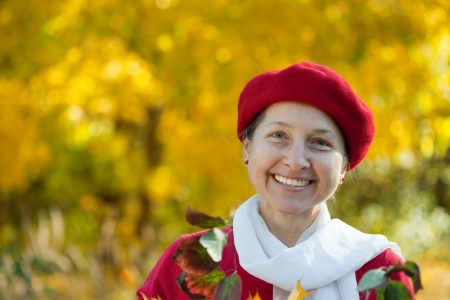 Portrait of  happy mature woman  in autumn park Stock Photo - 17357804
