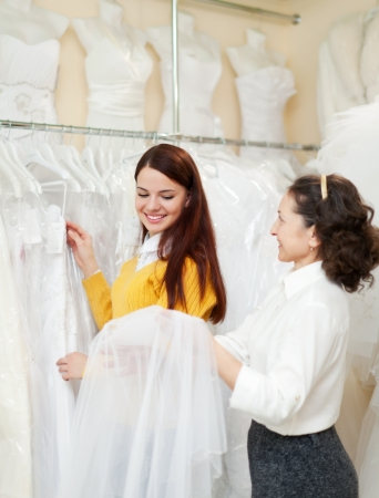 Two women  at wedding store  Focus on young bride  photo